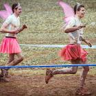 Two of the roughly 3,000 participants in Muennerstadt, Germany attempt to complete a 26k track loaded with mud holes, artificial obstacles and ice cold bodies of water. The most brutal part of the event? Having to wear these mandatory uniforms.