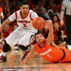 Syracuse guard Michael Carter-Williams dives for a loose ball as Louisville guard Peyton Siva reaches out for it in the championship game of the Big East Tournament on March 16. Louisville claimed the last tournament title of the current construction of the Big East with a 78-61 victory and earned it the No. 1 overall seed in the NCAA Tournament.