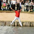 Prayad Marksaeng jumps into the water at the Thana City Golf and Sports Club after winning the Thailand Open on March 17. Marksaeng, a native of Thailand, won his own national open with a 24-under 262, two shots better than Australia's Scott Strange.