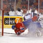 In the main game, the Canadiens prevailed over the Oilers, 4-3. Habs forward Richard Zednik (not pictured, that's Patrice Brisebois taking a tumble courtesy of Ryan Smyth) was credited with scoring the NHL's first open-air goal—39 seconds into the second period. It was the first of his two tallies on the night.