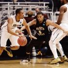 Pitt forward J.J. Moore sets a screen, allowing Trey Zeigler to make his move past the Shockers' Demetric Williams.