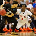Colorado's Asika Booker looks for a pass while Illinois' D.J. Richardson defends.