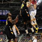 <bold>Defeated San Diego State 71-56</bold> <bold>Defeated VCU 78-53</bold> <bold>Next: vs. Kansas </bold>(<bold><italics>SI's live bracket</italics></bold>) <bold>Nik Stauskas and the Wolverines committed only 12 turnovers in their rout of VCU as they advanced to the regional semifinals for the first time since 1994.</bold>
