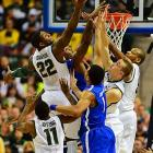 <bold>Defeated Valparaiso 65-54 Defeated Memphis 70-58 Next: vs. Duke </bold>(<bold><italics>SI's live bracket</italics></bold>) <bold>Branden Dawson and the Spartans outrebounded Memphis 41-25 as they moved on to the regional semifinals for the fifth time in six years and the 11th time in coach Tom Izzo's career.</bold>