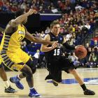 <bold>Defeated Davidson 59-58</bold> <bold>Defeated Butler 74-72</bold> <bold>Next: vs. Miami </bold>(<bold><italics>SI's live bracket</italics></bold>) <bold>Butler guard Rotnei Clarke drives against Marquette center Chris Otule in a game that went back and forth and came down to the last shot -- a Butler miss.</bold>