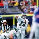 Cunningham throws a pass against the Giants in a 24-17 win at Giants Stadium.