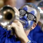 The most distinctive horn player since Dizzy Gillespie blows up a storm with the Memphis Tigers band during the team's tilt against St. Mary's in the tourney's second round at The Palace of Auburn Hills. The Tigers nearly blew a late lead, but hung to win, 54-52.