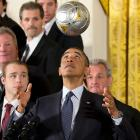Unlike Tim Thomas last year, LA Kings coach Darryl Sutter (<italics>right</italics>) bit his lip and kept his political 'pinions to himself as a soccer ball -- in honor of MLS's LA Galaxy -- bounced off the POTUS's forehead during a solemn White House ceremony. We suspect Mr. Thomas might have chortled at seeing a puck bounce off the Prez's noggin in honor of Sutter's reigning Stanley Cup champs.