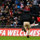We're running behind, so let us bring the proceedings to an end with this lovely shot of a chap who forgot his trousers when he invaded the pitch during a match between Wrexham and good ol' Grimsby Town at Wembley Stadium in London.