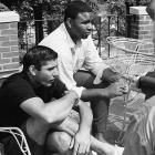 Joe Namath sits with Winston Hill during the Jets summer training at Peekskill Military Academy in Peekskill, NY.