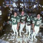 Joe Klecko, Marty Lyons, Abdul Salaam and Mark Gastineau pose of the floor of the New York Stock Exchange.