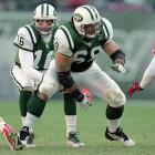 Vinny Testaverde takes the snap from center Kevin Mawae during a game against the Chiefs.