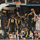 Carl Hall (22) and the Shockers out-rebounded Louisville 35-32.