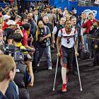 Kevin Ware rejoined the Cardinals on the bench, less than a week after snapping his tibia in the regional final.