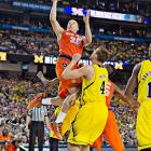 """Triche, shooting here against Mitch McGary, blamed himself for driving the ball recklessly into the lane when Syracuse trailed 58-56. """"I was just trying to make a play for the team,'' he said. """"I probably should have made a better decision, probably should have pulled up for the jump shot. ... I did see him [Jordan Morgan], but I figured, I was already in the air jumping.''"""