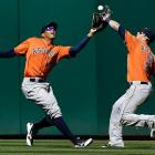Astros right fielder Brandon Barnes (2) and center fielder Justin Maxwell reach for a fly ball hit by the Oakland A's Shane Peterson. The Athletic won 7-5.