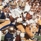 "Legend holds that Notre Dame let the grass grow tall before its 1976 season opener against Dorsett and Pittsburgh. ""They didn't let that grass grow long enough,"" Dorsett said after rushing for 181 yards. As a 155-pound freshman, Dorsett ran for more than 1,500 yards. By his senior season, he had packed on 40 pounds of muscle. He was stronger and smarter as a runner, and he won the Heisman Trophy after a dominant season. He ran for 2,150 yards and 22 touchdowns that year."