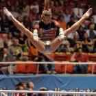 """Kupets' college coach called her the """"Muhammad Ali of gymnastics"""" after she closed her career as the sport's most decorated collegian. After Kupets won a bronze medal in the uneven bars at the 2004 Olympics, she showed her all-around dominance at Georgia. She was the first college gymnast to win individual titles in every event, and her four titles during her senior season gave her a record nine NCAA championships. Georgia won the team title during all four seasons she competed."""