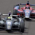 Tony Kanaan pumps his fist in front of Marco Andretti to celebrate after winning the Indianapolis 500.