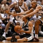 The Nets' Anthony Johnson and Richard Jefferson surround Parker during Game 4 of the 2003 NBA Finals. San Antonio won the series 4-2.