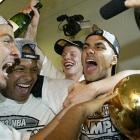 Parker celebrates with the championship trophy after the Spurs defeated New Jersey in six games. It was the second championship in franchise history.