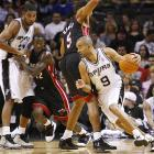 Parker has been adept at using Tim Duncan screens to break down opponents. Here they do so against Juwan Howard and the Heat.