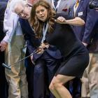 The former supermodel and SI swimsuit icon was seen puttering around with the likes of financial big wig Warren Buffet and Ndamukong Suh, the Detroit Lions' famously gentle defensive end, at the Berkshire Hathawy shareholders meeting in Omaha, Neb.