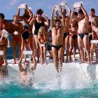 Members of the swimming club bring their own ice as they jump into the drink at Sydney's Bondi Beach to uncork their winter swimming season.