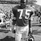 """David """"Deacon"""" Jones, a Hall of Fame defensive end credited with terming the word sack for how he knocked down quarterbacks, died at age 74 of natural causes at his home in Southern California on June 3, 2013. Jones was the leader of the Rams' Fearsome Foursome unit from 1961-71 and then played for San Diego for two seasons before finishing his career with the Redskins in 1974. He was inducted into the Pro Football Hall of Fame in 1980 and made the league's 75th anniversary all-time squad. Because sacks didn't become an official statistic until 1982, Jones' total is uncertain. His impact as a premier pass rusher and team leader is not. Jones made the Pro Bowl every year from 1964-70 and played in eight overall."""