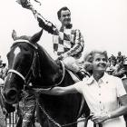 Mrs. Penny (Tweedy), the owner of Secretariat, leads her horse and Turcotte to the Winners Circle.