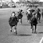 Secretariat set a track record of 1:59 2/5 in winning the 1¼ mile Kentucky Derby.