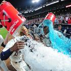 B.J. and Justin Upton are doused by teammates, including Chris Johnson, following the Braves 6-5 win over the Cubs. The Upton brothers had both hit solo home runs in the ninth inning.