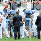 Clayton Kershaw is doused by teammate Matt Kemp following the Dodgers 4-0 win over the Giants on opening day. Kershaw had launched his first career home run to break a scoreless tie in the eighth inning before finishing off a four-hit shutout.