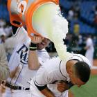 Desmond Jennings is doused by teammate Evan Longoria following the Rays 7-6 win over the Marlins. Jennings went 3-for-4 with the game-winning RBI single in the ninth inning.