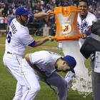 Eric Hosmer avoids being doused by teammates George Kottaras and Salvador Perez following the Royals 4-2 over the Astros. Hosmer went 2-for-4 with two runs in the game.