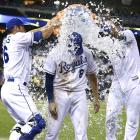 Mike Moustakas is doused by teammates George Kottaras and Salvador Perez following the Royals 8-2 win over the Rays. Moustakas went 2-for-3 with a home run and 3 RBI in the game.