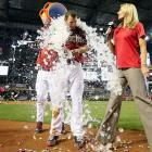 Paul Goldschmidt is doused by a teammate as he is interviewed by sideline reporter Jody Jackson following the Diamondbacks 1-0 win over the Dodgers. Goldschmidt hit the game-winning RBI single in the ninth inning.