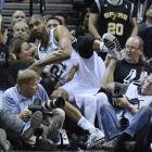 A 15-year veteran, Tim Duncan is still hustling for loose balls and fighting underneath for offensive rebounds. He went into the crowd after tossing a ball to a teammate before it went out of bounds.