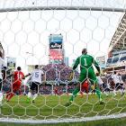 U.S. goalkeeper Tim Howard defends his net.
