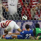 Dempsey clashes with Jonathan Lopez (23) as the ball finds its way past goalkeeper Ricardo Jerez for the United States' second goal of a 3-1 win over Guatemala at Livestrong Sporting Park in Kansas City.