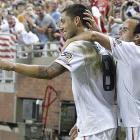 Dempsey celebrates with Landon Donovan after Dempsey's goal helped lift the U.S. past Canada, 2-0, in the 2011 Gold Cup at Ford Field in Detroit.
