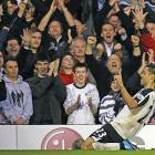 Dempsey soon became a household name at Craven Cottage, as he celebrates a goal vs. Liverpool in front of the Fulham faithful.