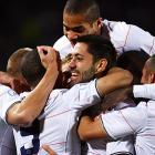 Dempsey is mobbed by teammates after striking again just four days later to give the United States an early 1-0 lead over Brazil.