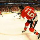Chicago's Michael Frolik flings the puck towards the Bruins' net. Frolik assisted on the goal by Johnny Oduya that tied the game at 3-3 in the third period.