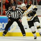 Bruins center David Krejci fires a puck up ice. Krejci, the leading postseason scorer, earned assists on the goals by Milan Lucic that staked Boston to a 2-0 lead.