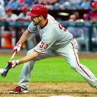 The Phillies pitcher bunts against the Diamondbacks on May 11, 2013 at Chase Field.