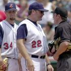 Lee led the Indians with 161 strikeouts in 2004 in his first full year with the club. He also tied Jake Westbrook for a team-leading 14 wins. In this photo he has just been ejected for throwing at Ken Griffey Jr.