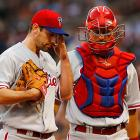 Lee returns to the dugout with catcher Erik Kratz after retiring the side in a game against the Red Sox on May 28. The Phillies won the game, 3-1.