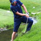 """England's Luke Donald gives a new meaning to golf's """"going swimming"""" as he chips a ball out of the deep rough during Round 4 of the U.S. Open. Donald finished tied for eighth at six over par."""