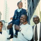 Smith poses with his family outside the 1985 NFL Draft. Smith was the number one overall pick.